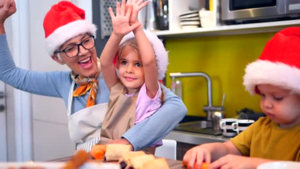 Grandma and grandchildren preparing Xmas meal in the kitchen in cheerful atmosphere together. Christmas, family, together. slow motion footage video