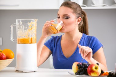 Young girl drinking tasty juice