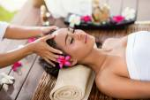 Asian woman in the spa salon, massage the head