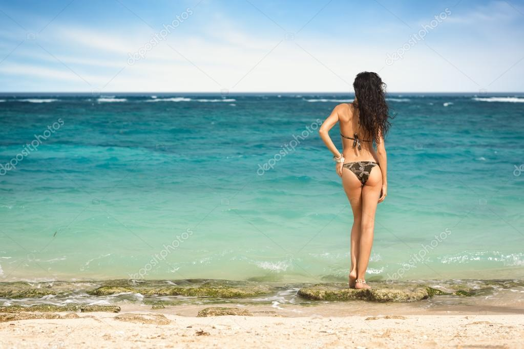 c977552b309 Sexy woman in small bikini on the beach — Stock Photo ...