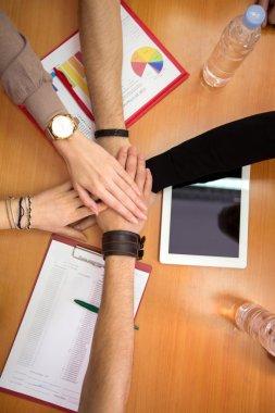 Hands together team unity concept