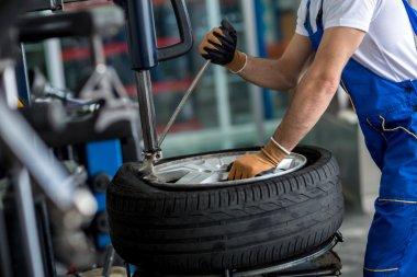 engineer  balancing  car wheel on balancer