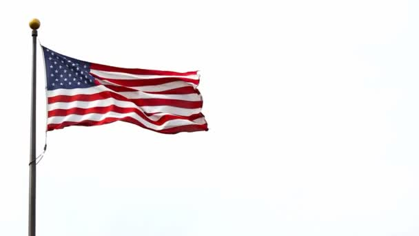 Stars and Stripes flag of the United States of America flying high on a windy day close up 1080p