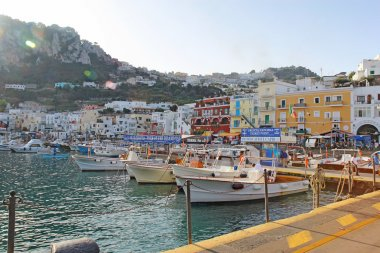 Tour boat booths, signs and buildings at Marina Grande, Capri, I