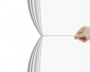 Human hand pulling open white blank curtain with empty behind