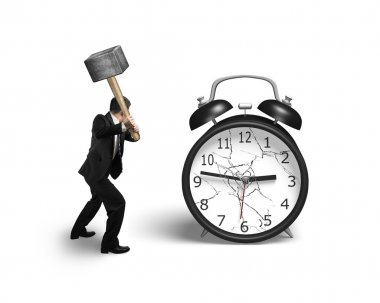 businessman hand holding sledgehammer hitting alarm clock with b