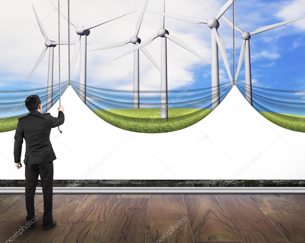 businessman pulling open wind turbines curtain covered blank whi