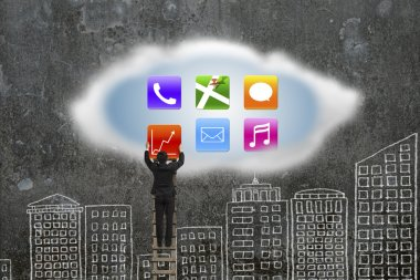 climbing businessman getting app icons from cloud with doodles w