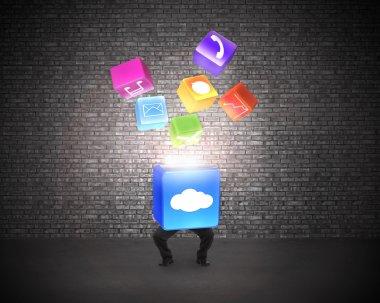 Man holding cloud box illuminated app icons with brick wall
