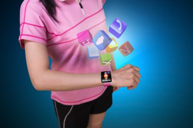 Sport woman wearing touchscreen smartwatch with colorful app ico