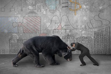Businessman fighting against black bear with business concept do