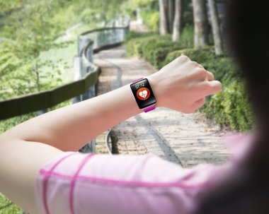 Sport woman looking at health sensor smart watch hand wearing