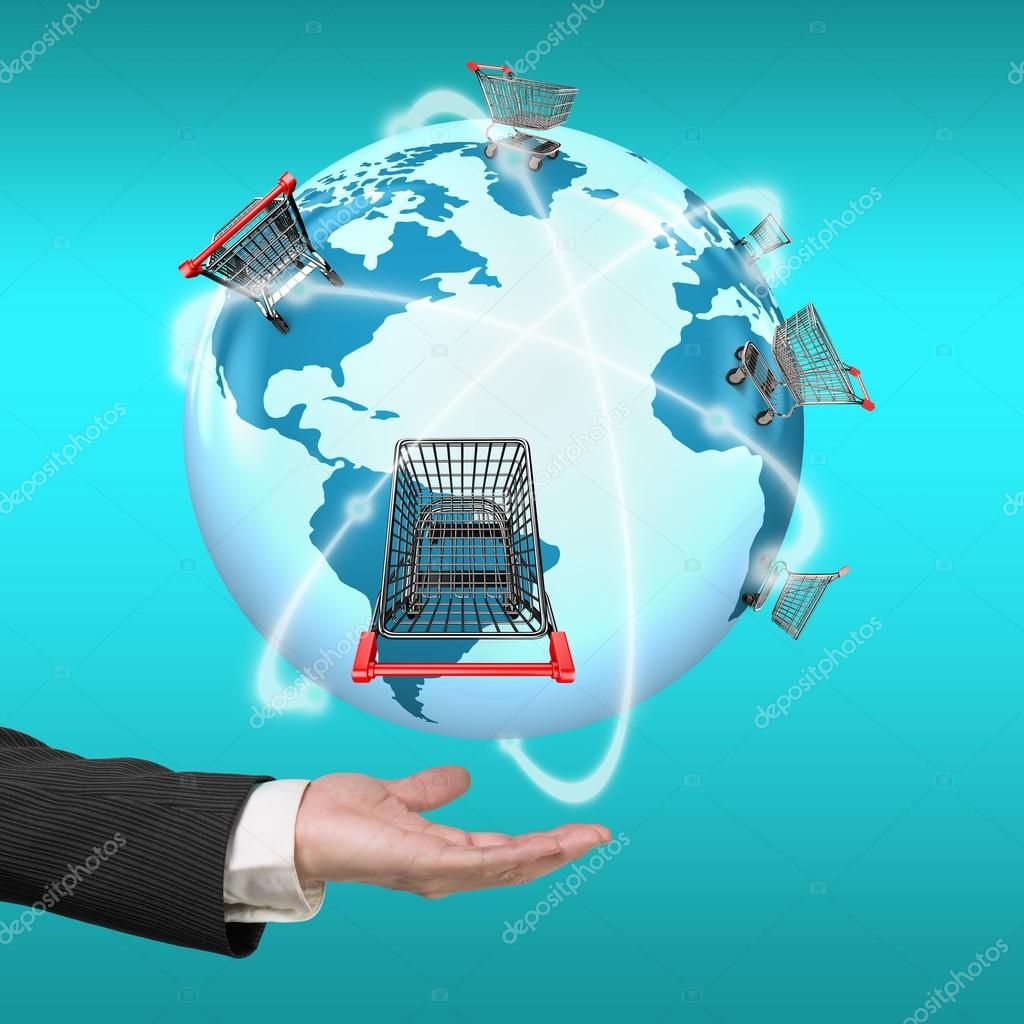 Hand showing 3d globe world map of shopping carts worldwide stock hand showing 3d globe world map of shopping carts worldwide stock photo gumiabroncs Choice Image