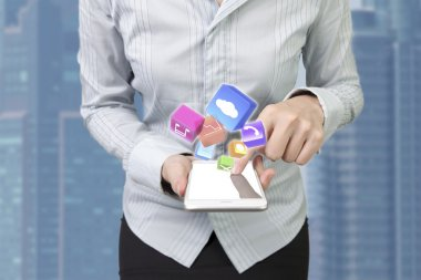 Woman using smartphone finger touching screen color app icons