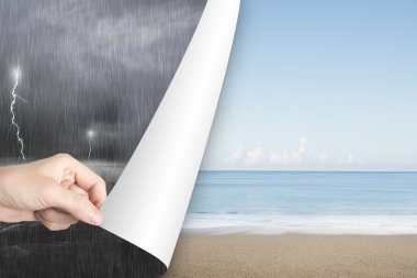 Woman hand open calm beach page replace stormy ocean