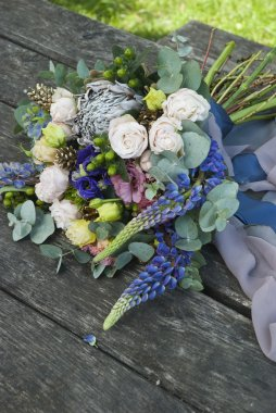 Wedding bouquet of beautiful flowers on wooden surface