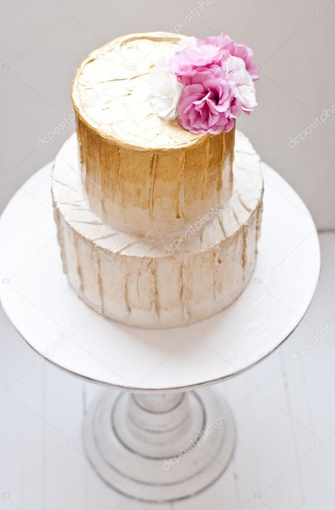 Gold and white wedding cake and pink flowers around stock photo gold and white wedding cake and pink flowers around stock photo mightylinksfo