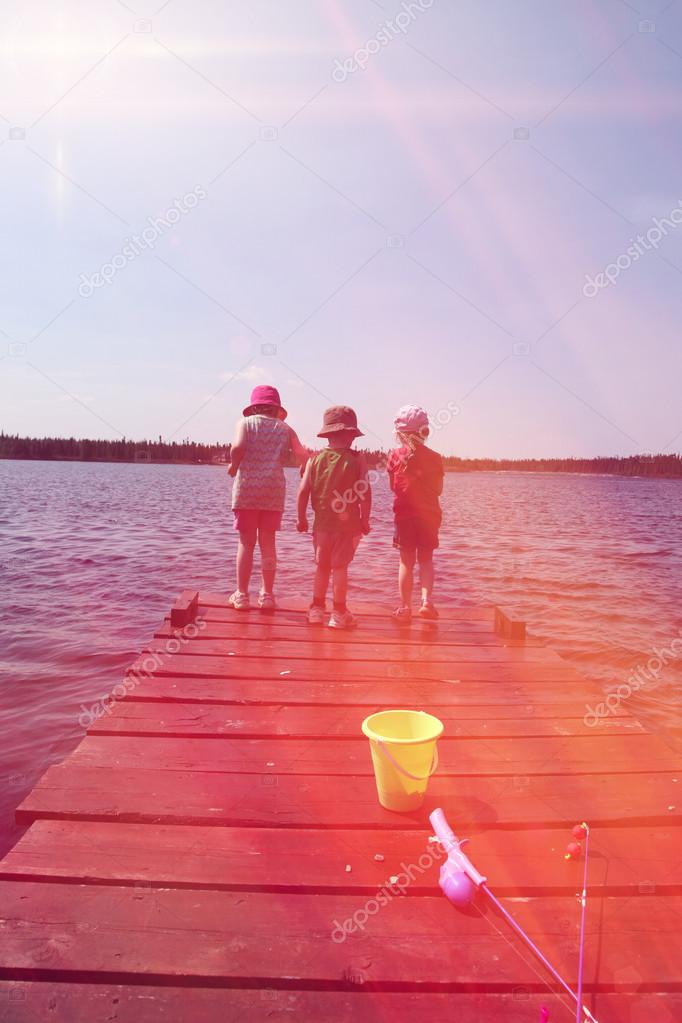 Children on dock fishing