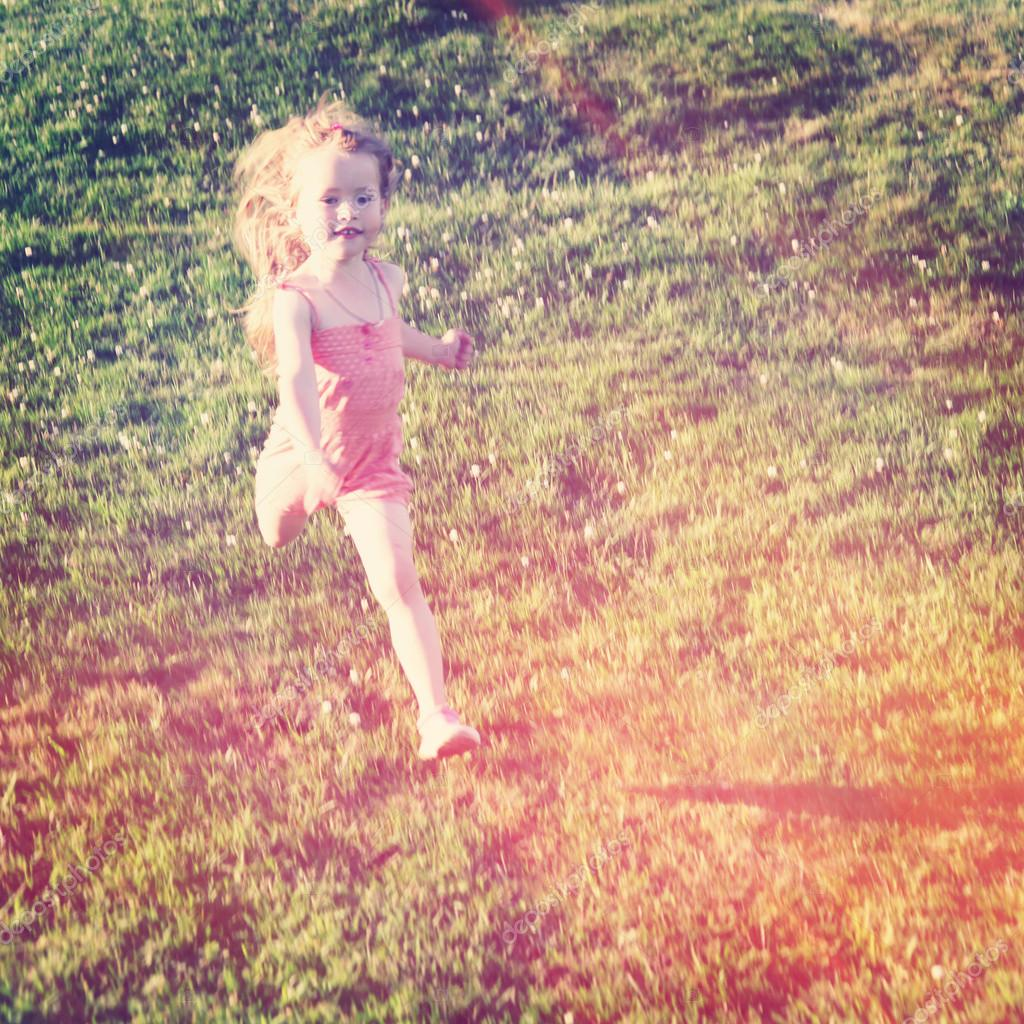 Little Girl running in the grass