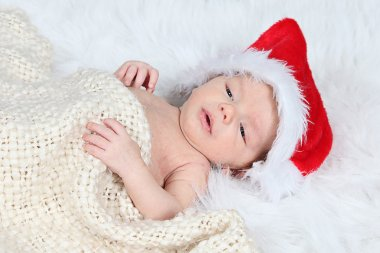 Little baby boy in  Christmas hat