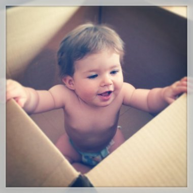 Little baby girl in shipping box