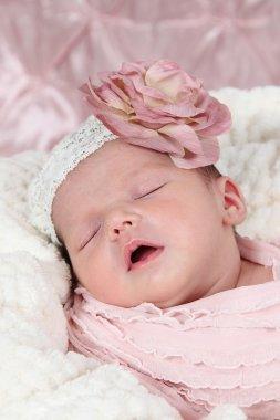 Newborn Girl sleeping in crib