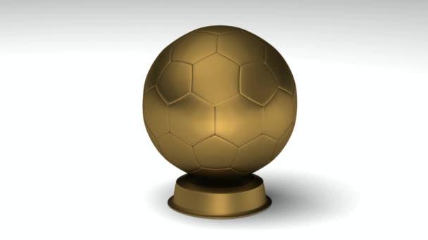 Közelről egy fordult arany labdarúgó trófeát