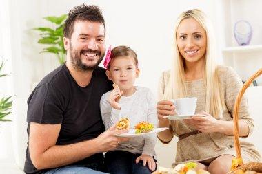 Happy Family Eats Pastry For Breakfast