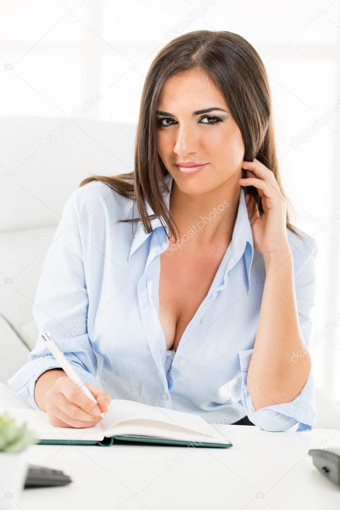 Sexy Businesswoman With Cleavage Stock Photo