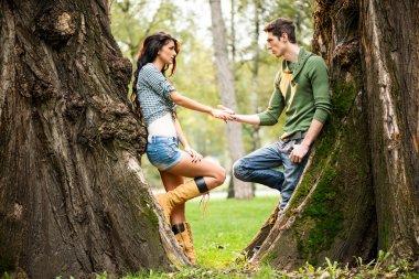 Romance Beside A Tree Trunk