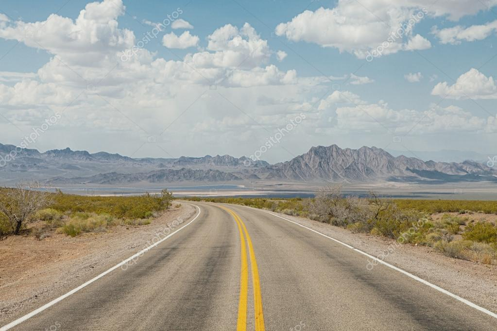 panoramic view of hot summer road through the Nevada  desertpanoramic view of hot summer road through the Nevada  desert