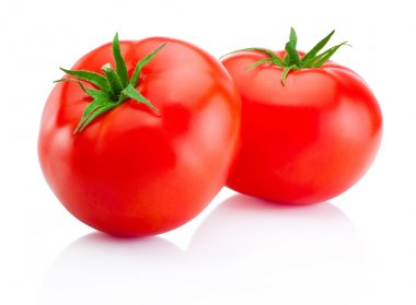Two red tomatoes isolated on white background