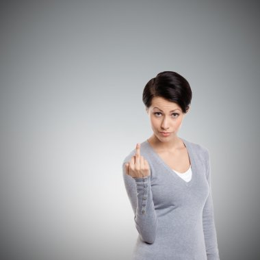 Attractive woman shows an obscene finger sign