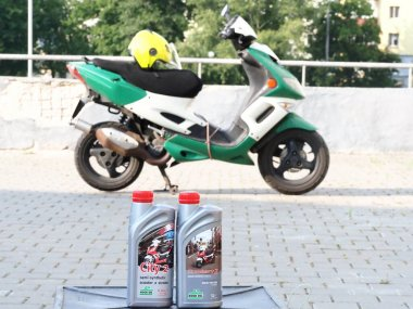Belarus, Minsk,2021.motor oil on the background of a scooter in the city