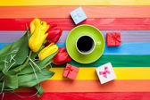 Fotografie Cup of coffee with tulips and gifts