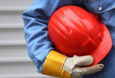 Man holding red helmet close up, shallow dof stock vector
