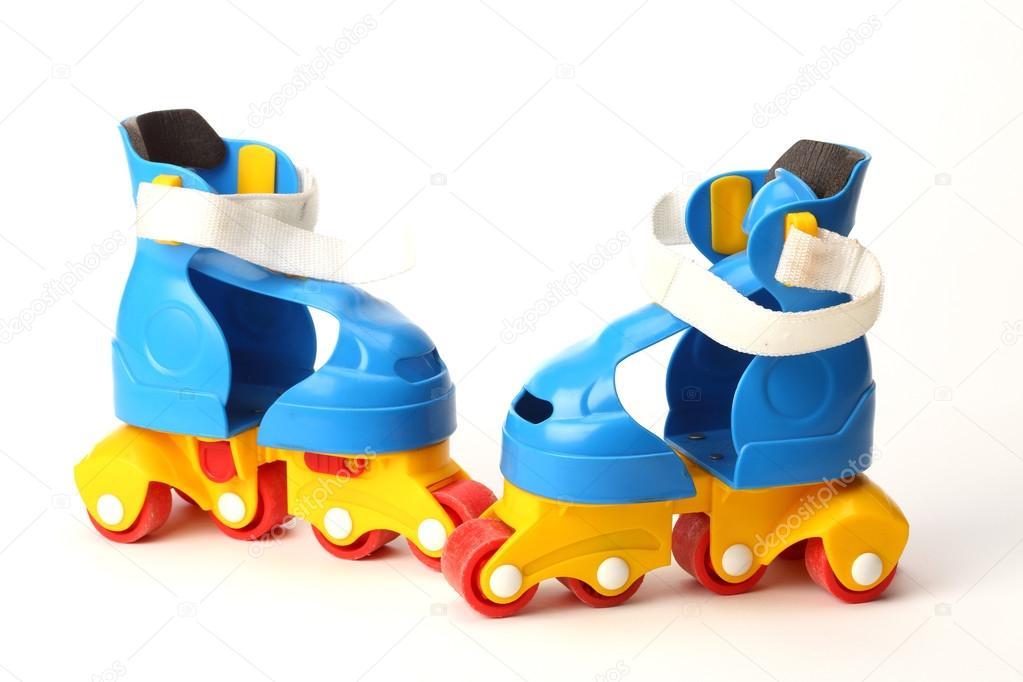 Πλαστικά πατίνια — Φωτογραφία Αρχείου. Colorfull plastic roller skates on  white background — Εικόνα από AlexKosev 87c132e9618