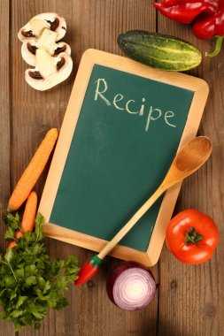 Chalkboard and fresh organic vegetables stock vector