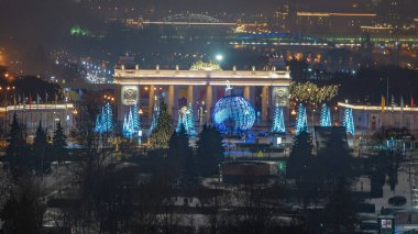 MOSCOW - December 31, 2020: The gate of Gorky Park at night in Moscow, Russia. It is the central Moscow park, located in the heart of the city.