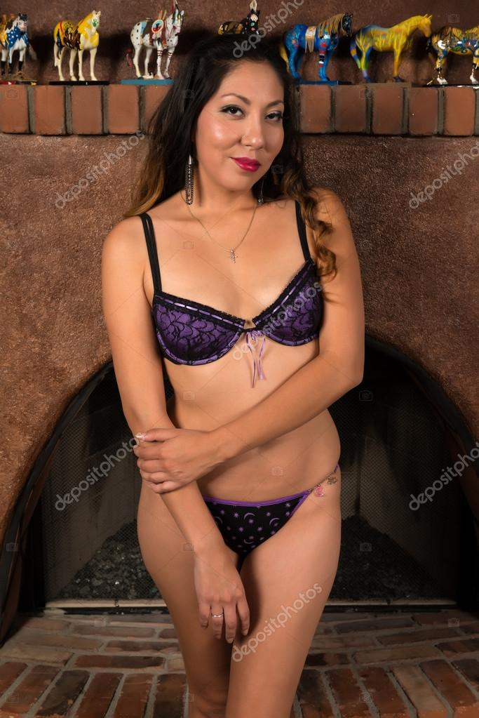 d1edf4703e5 Pretty petite Native American woman in front of a fireplace — Photo by ...