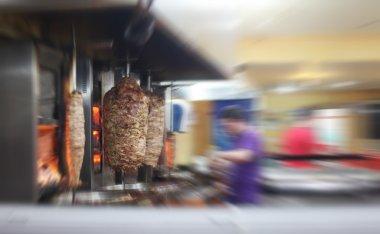 Turkish doner kebab in restaurant. Blur motion interior.
