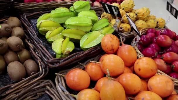 Green carambola fruits and kiwi