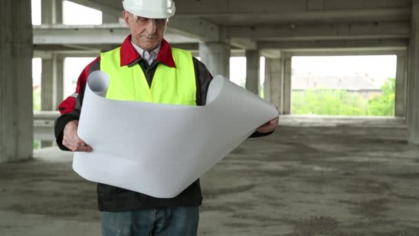 Master builder with design drawings at construction site