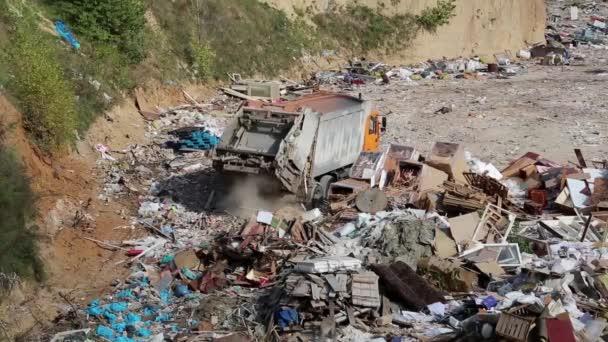 Garbage truck unloads waste