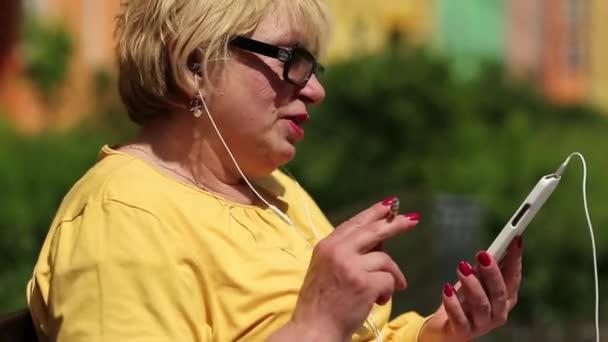 Woman communicates via smartphone