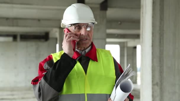 Civil engineer with cell phone