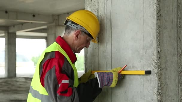 Worker in hard hat with level