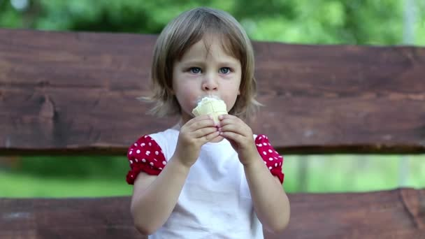 Little girl eats ice cream