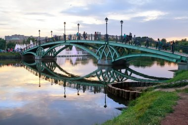 Romantic bridge over a pond in a park. Moscow.