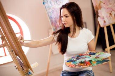 Female Artist Working On Painting In Studio stock vector